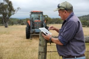 Farmer in the field on an ipad