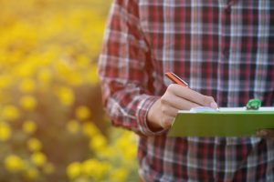 Farmer recordkeeping in a field