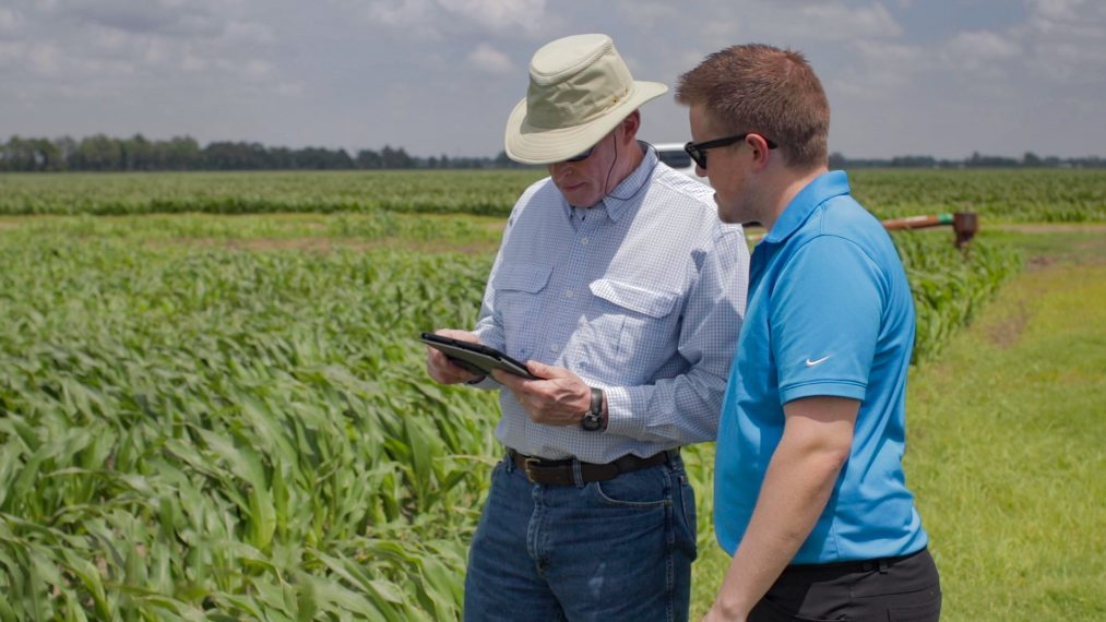 Farmer in the Field Recordkeeping with Tablet